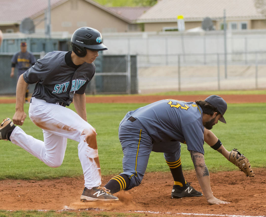 Bonanza first baseman Danny Ruiz (13) tags Silverado pitcher Christian Hernandez (32) out in ...