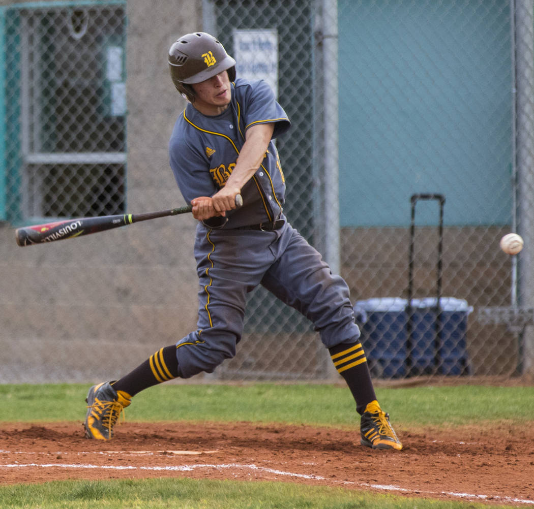 Bonanza shortstop Luis Lares (17) hits a single in the third inning during a baseball game a ...