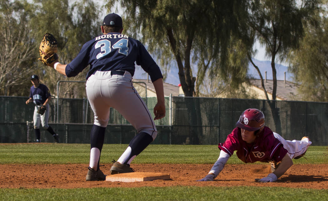 Desert Oasis shortstop Cole Schaefer (10) successfully slides back into first after trying t ...