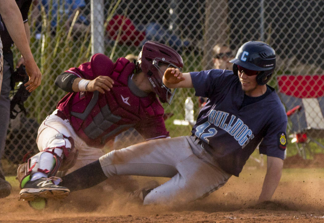 Centennial infielder Jake Rogers (42) slides into home plate during the championship game of ...