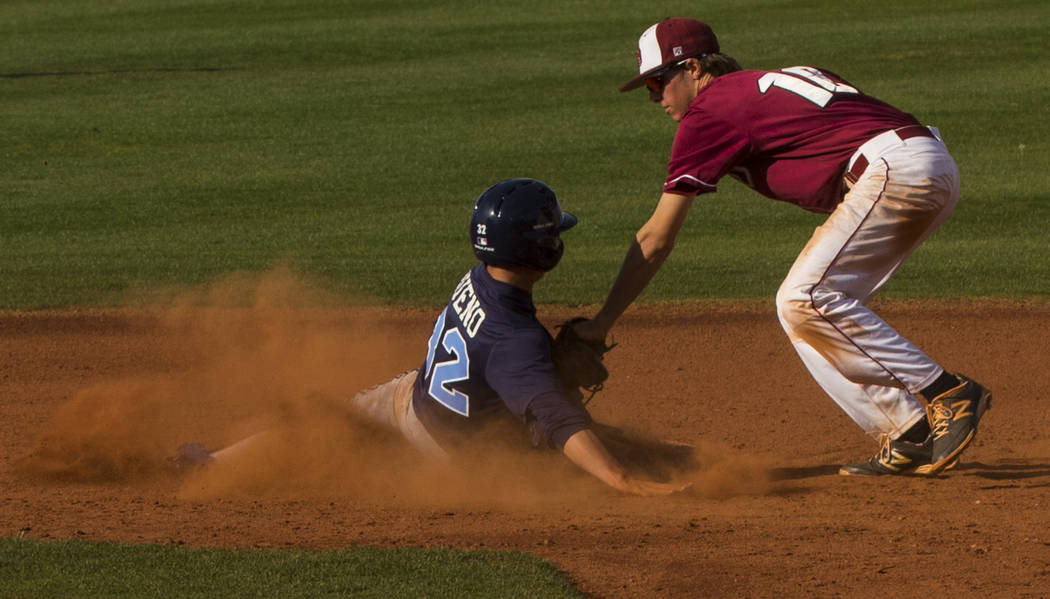 Centennial infielder Alex Bueno (32) is tagged out by Desert Oasis shortstop Cole Schaefer ( ...