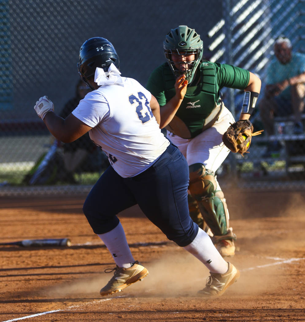Shadow Ridge first baseman Alyssa Stanley (22) is tagged out while running back to third bas ...