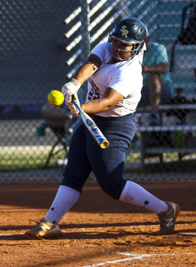 Shadow Ridge first baseman Alyssa Stanley (22) hits a double in the sixth inning during a so ...