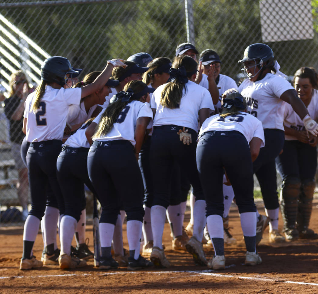 The Shadow Ridge softball team celebrates the home run hit by first baseman Alyssa Stanley ( ...