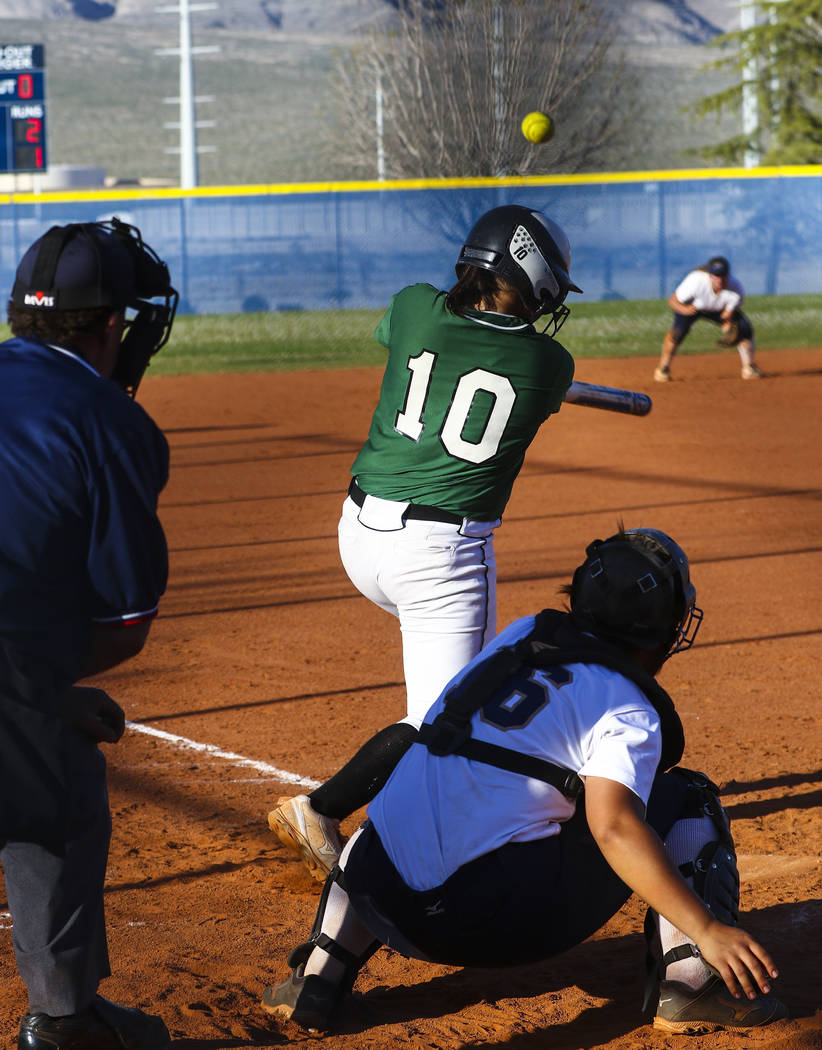 Palo Verde infielder Richmond Garcia (10) hits the ball in the sixth inning during a softbal ...