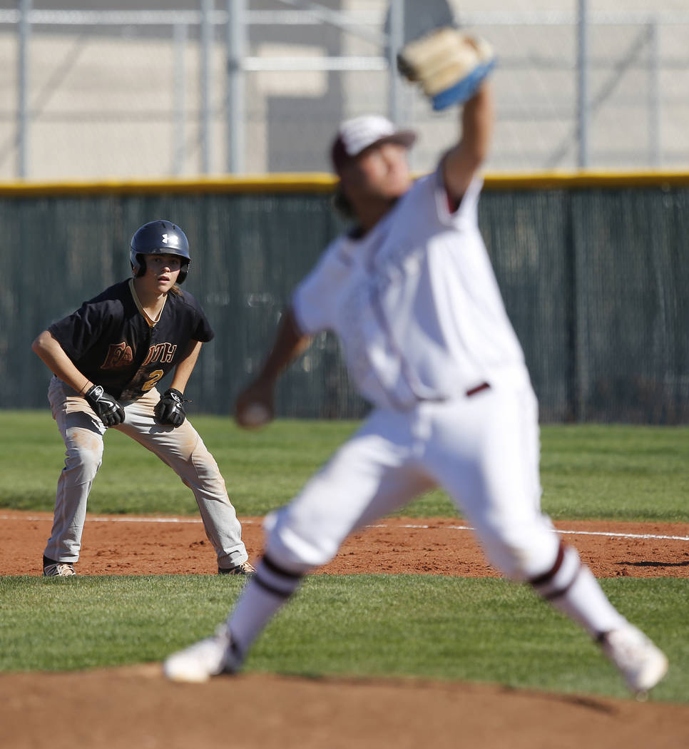 Faith Lutheran's Paulshawn Pasqualotto (2) leads off first base as Cimarron-Memorial&# ...