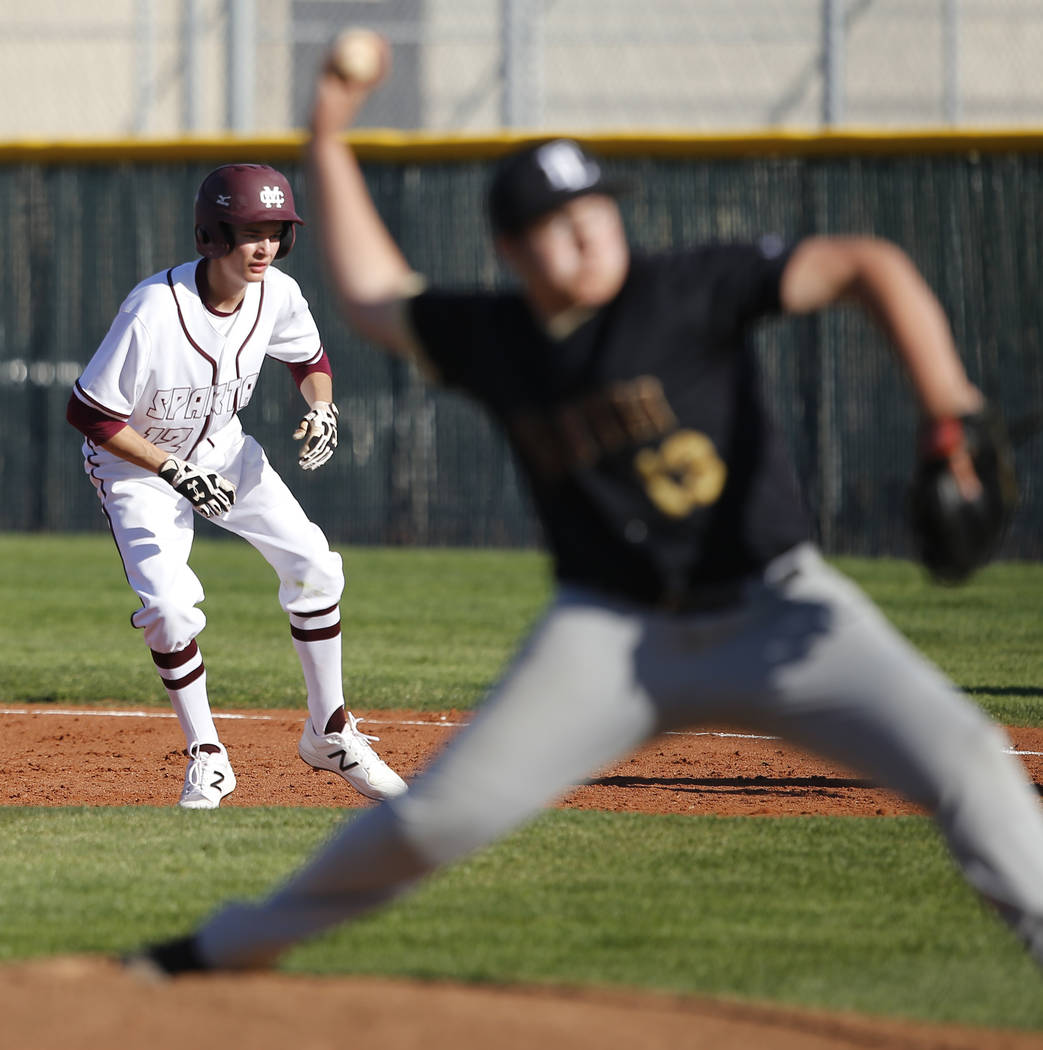Cimarron-Memorial's Jack Kannon (12) leads off first base as Faith Lutheran's Au ...