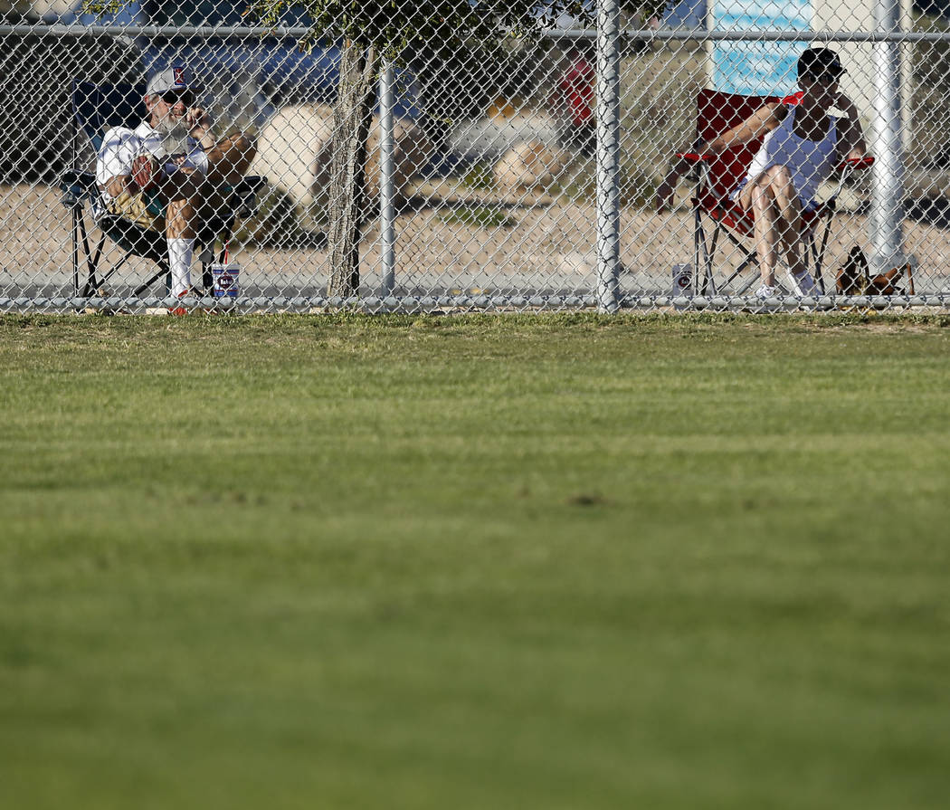 Spectators watch a high school baseball game on Tuesday, March 14, 2017, in Las Vegas. (Chri ...