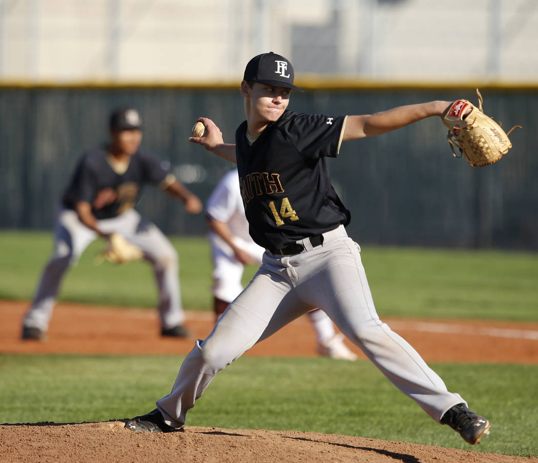 Faith Lutheran's Daren Dunaway (14) pitches during a high school baseball game against ...