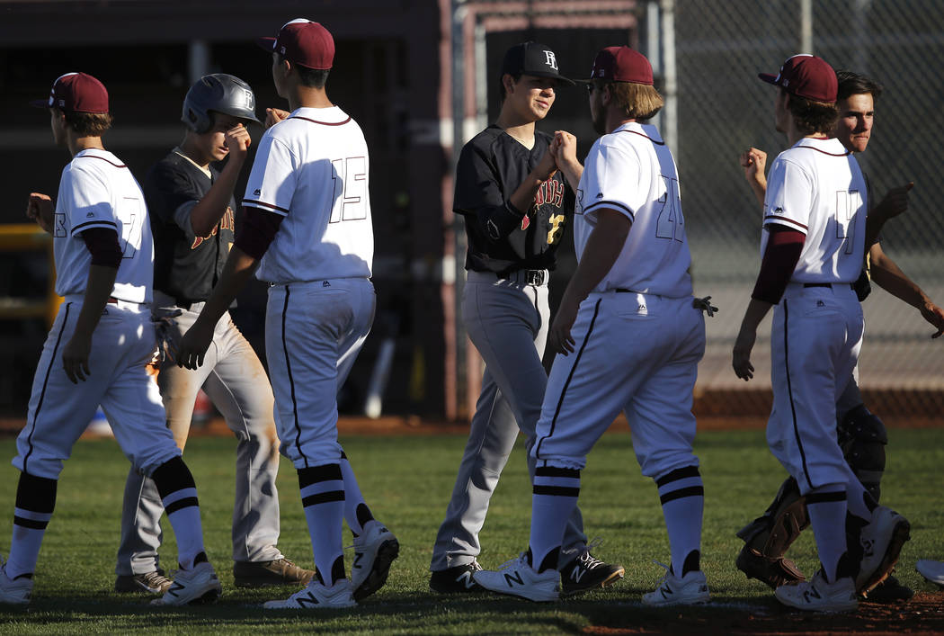 Cimarron-Memorial and Faith Lutheran athletes bump fists after a high school baseball game o ...