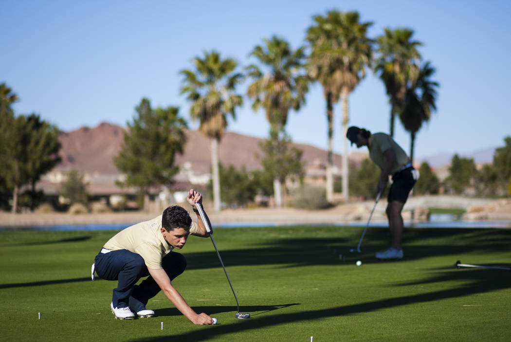 Foothill sophomore Noah MacFawn lines up his shot during practice at Chimera Golf Club in He ...