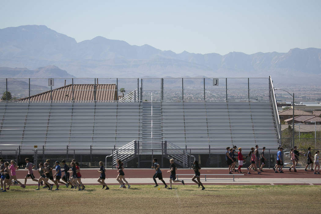Track and field teammates warm up during a practice at Coronado High School on Tuesday, Marc ...