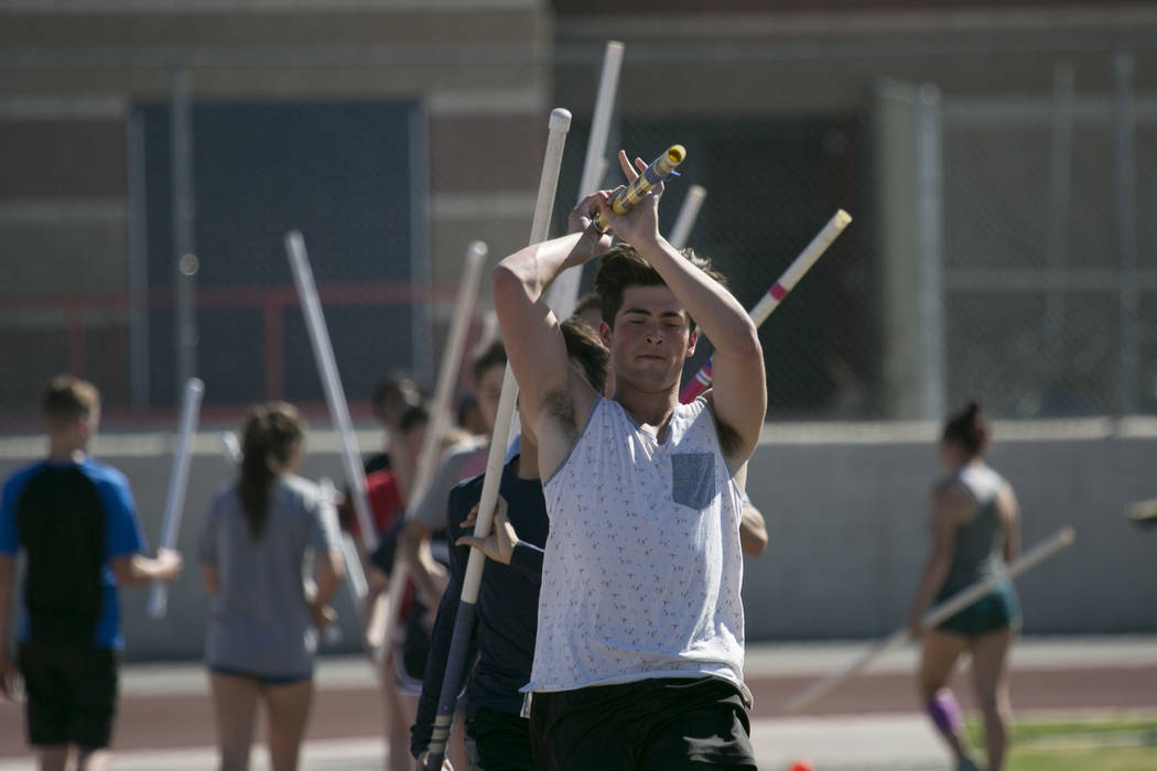 "Edward ""Teddy"" Andrews does warmup runs prior to pole vaulting during a tr ..."