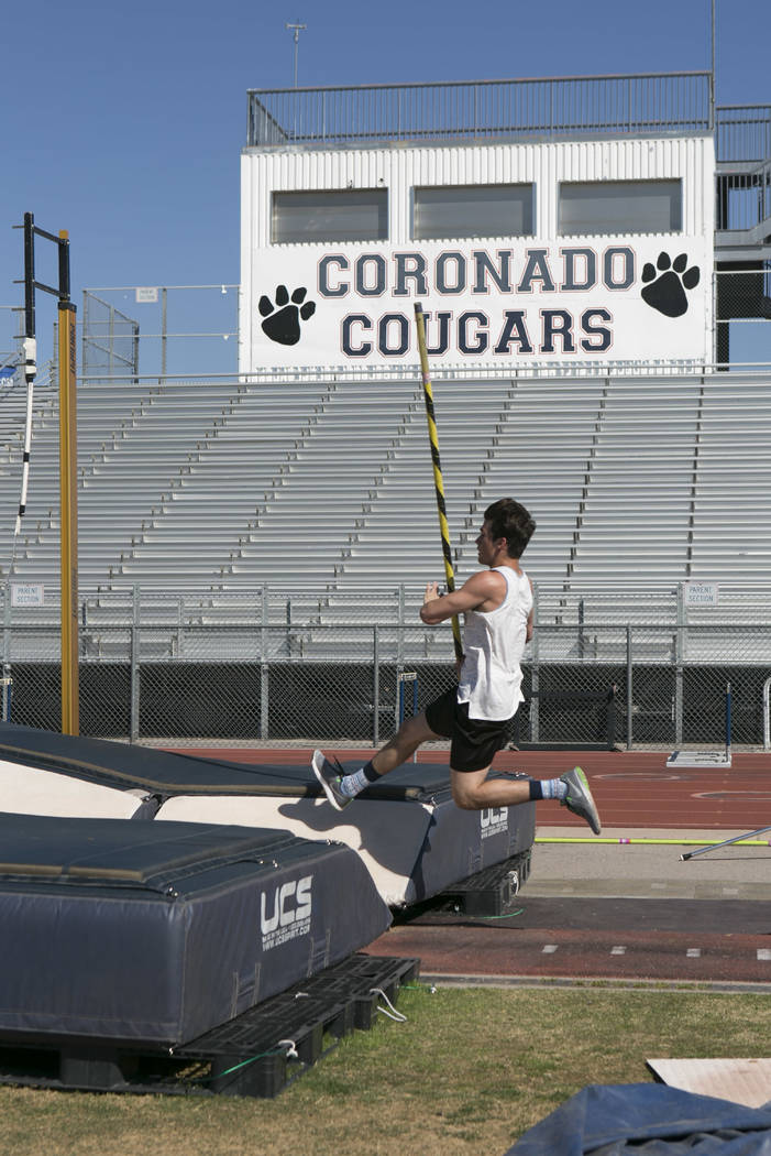 "Edward ""Teddy"" Andrews practices pole vaulting during a track and field pr ..."