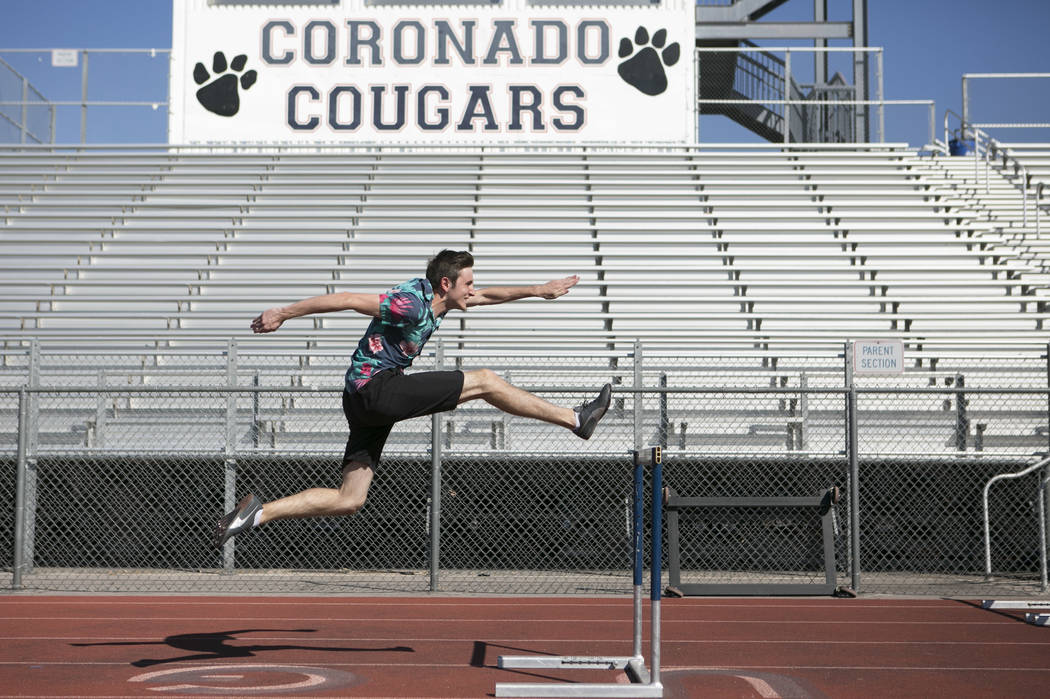 Braeden Traficanti practices hurdles during a track and field practice at Coronado High Scho ...