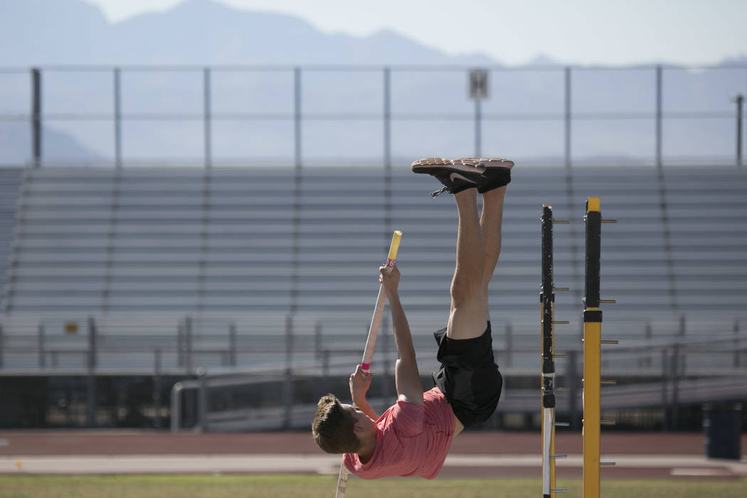 Garett Furlong practices pole vaulting during a track and field practice at Coronado High Sc ...
