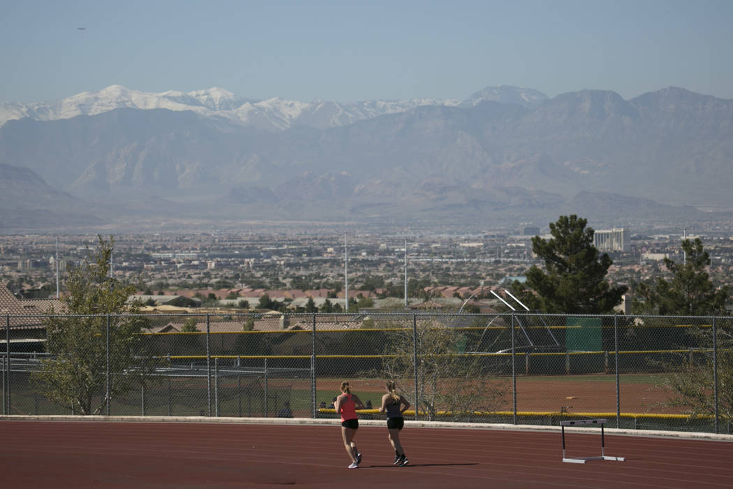 Track and field teammates warm up during a track and field practice at Coronado High School ...