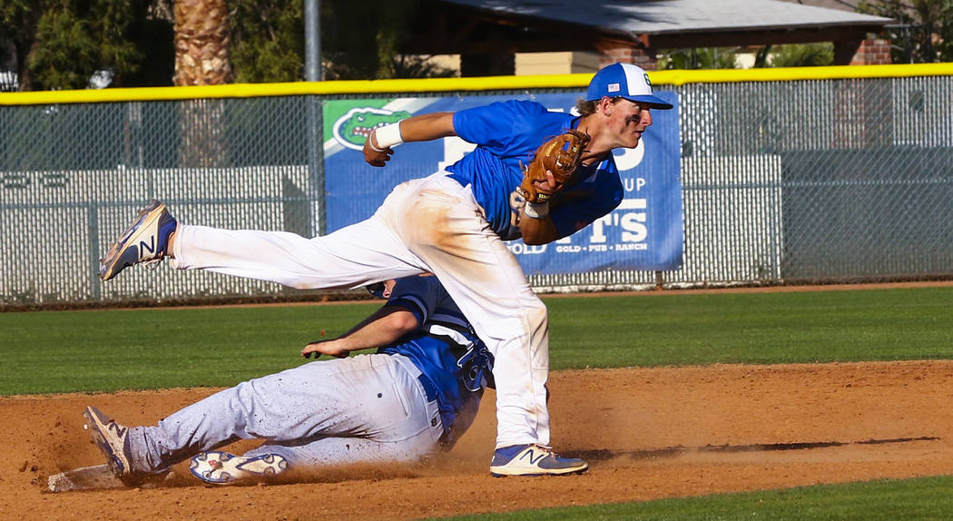 Basic third baseman Trace Evans (18) is tagged out at second base by Green Valley infielder ...