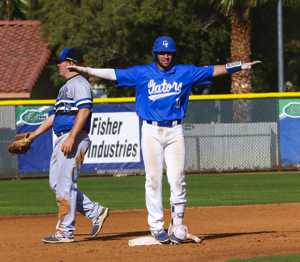 Green Valley shortstop A.J. Amelburu (11) celebrates hitting a double at second base in the ...