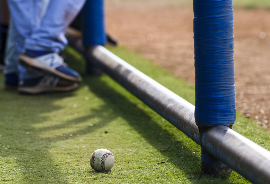 A baseball sits in the Basic High School dugout during a baseball game against Green Valley ...