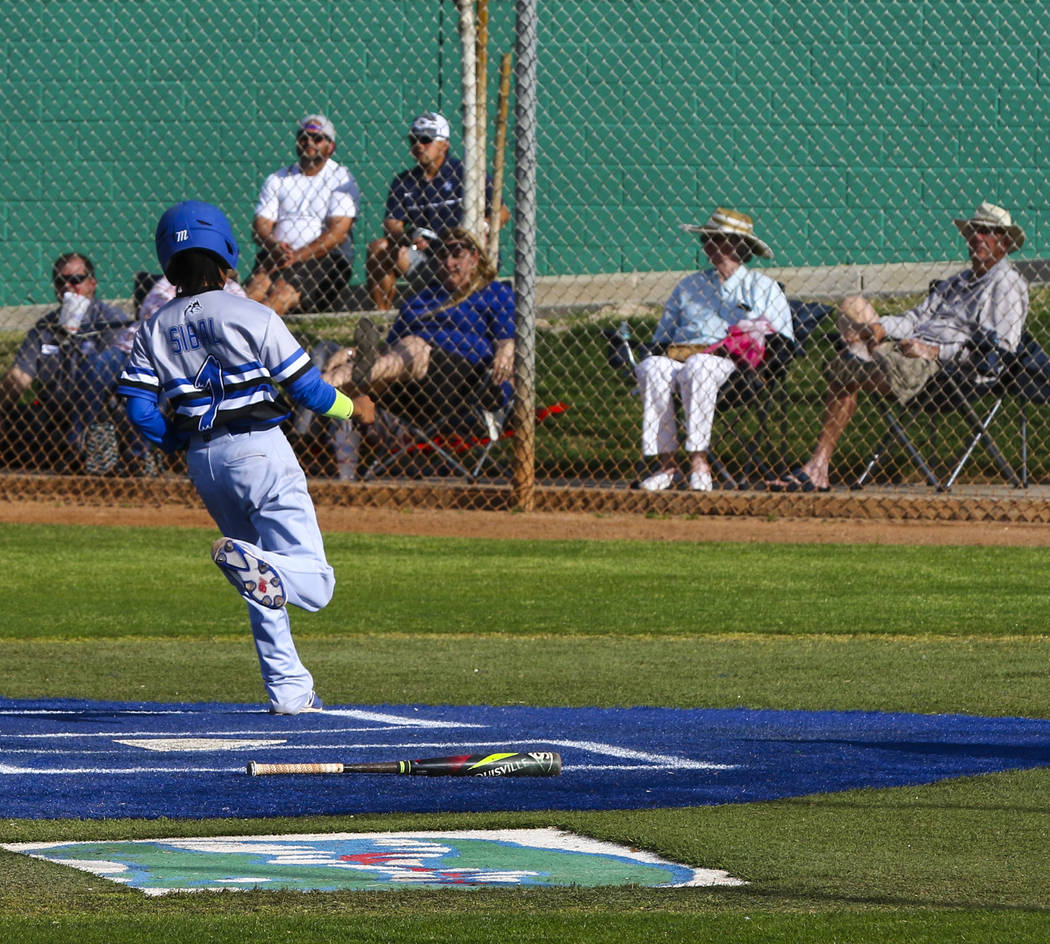 Basic second baseman Jathan Sibal (1) makes the run in the fourth inning during a baseball g ...