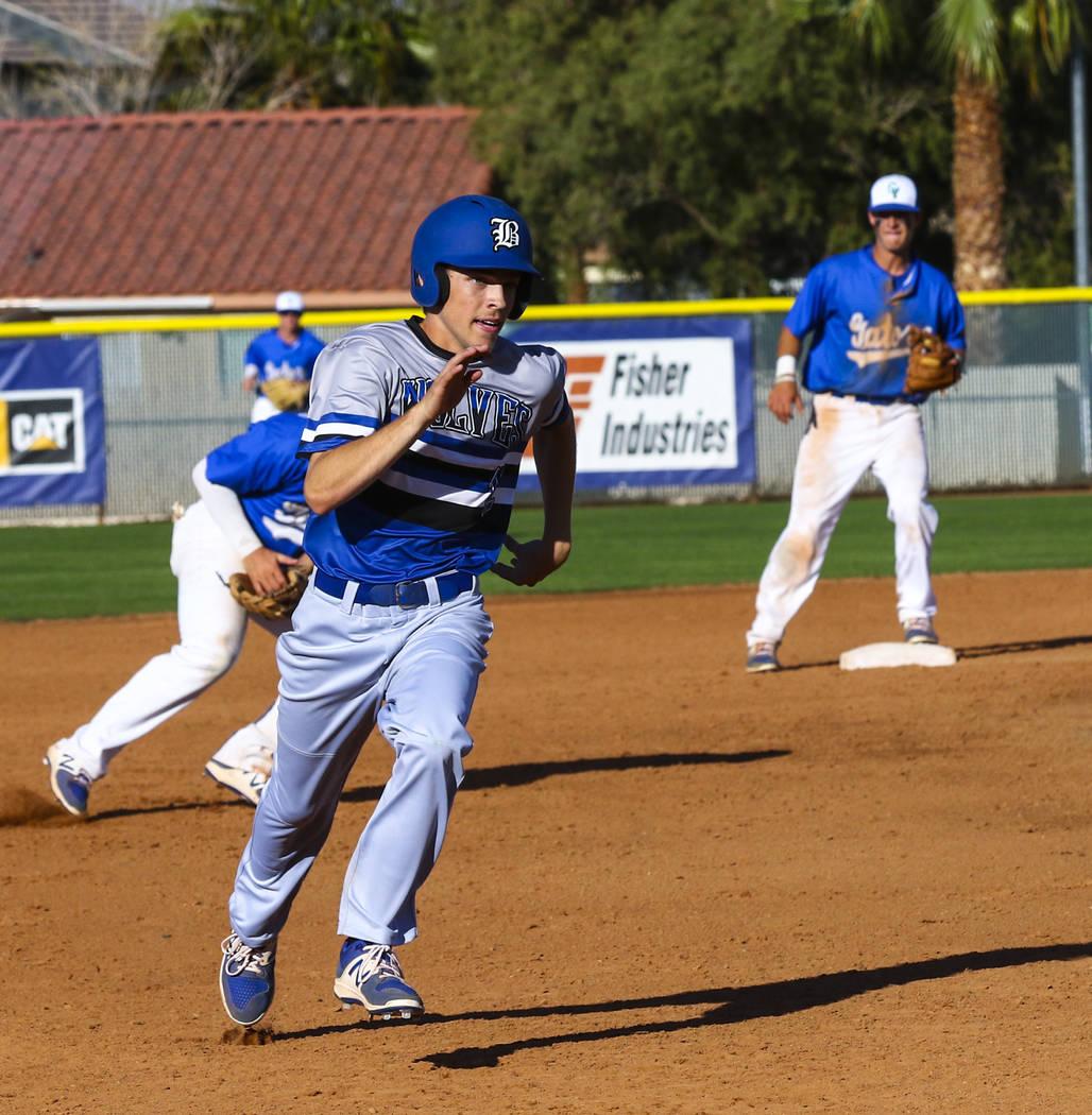 Basic second baseman Brady Clark (12) runs to third base in the sixth inning during a baseba ...