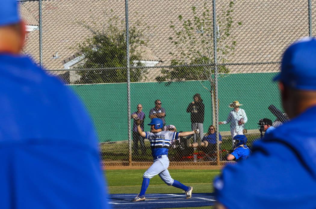 Basic second baseman C.J. Dornak (9) hits the ball in the fifth inning during a baseball gam ...
