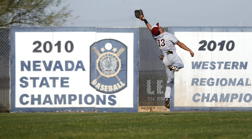Desert Oasis's Nic Lane (13) catches a fly ball during the fifth inning of a high scho ...