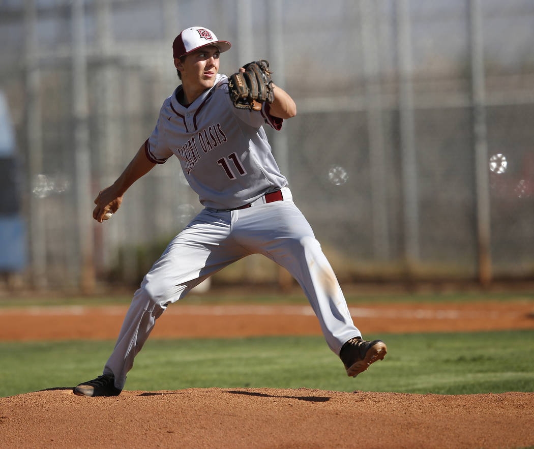 Desert Oasis's Brett Brocoff (11) pitches during the first inning of a high school bas ...