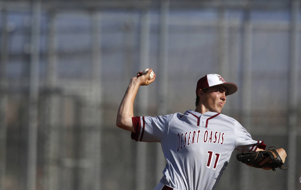 Desert Oasis's Brett Brocoff (11) pitches during the third inning of a high school bas ...