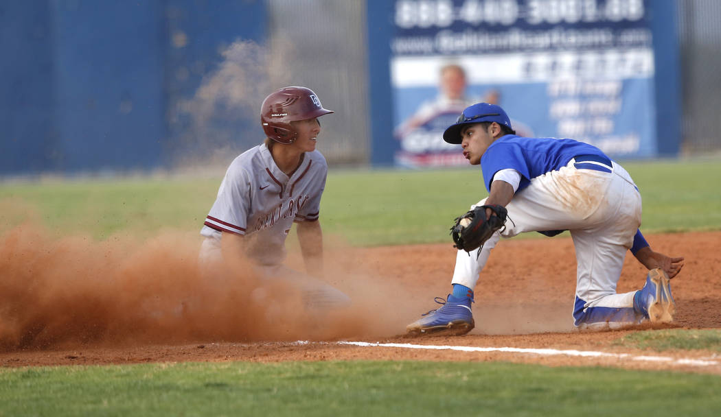 Desert Oasis's Cole Schaefer (10) is safe at third base after a late catch by Sierra V ...