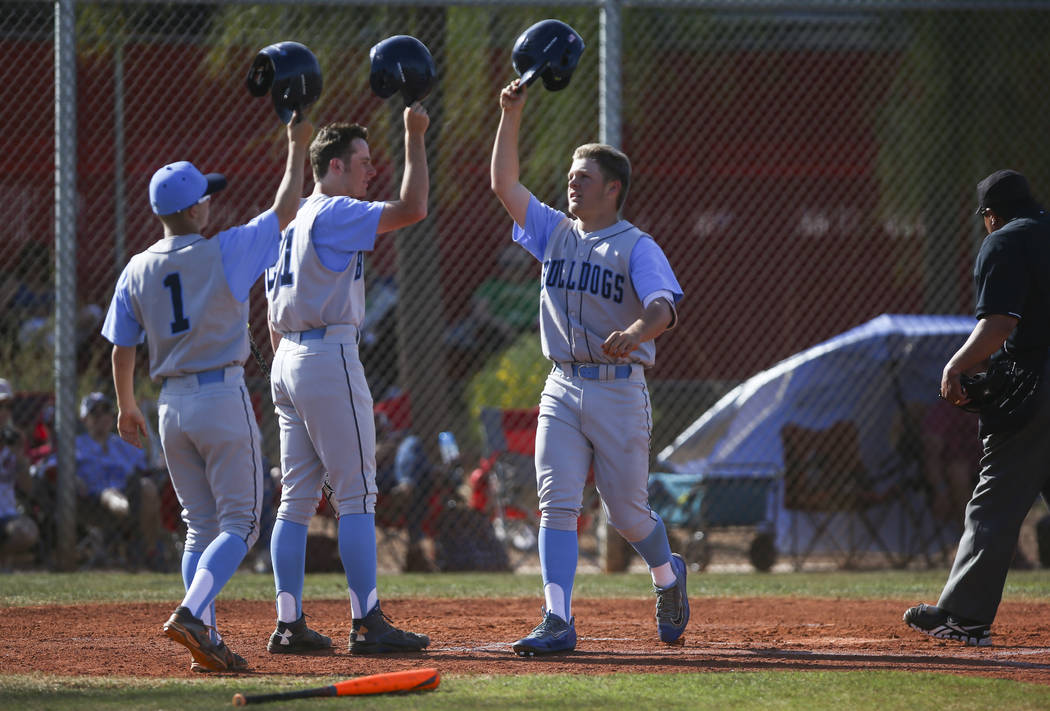 Centennial's Austin Kryszczuk (17), right, celebrates his home run hit during a baseba ...
