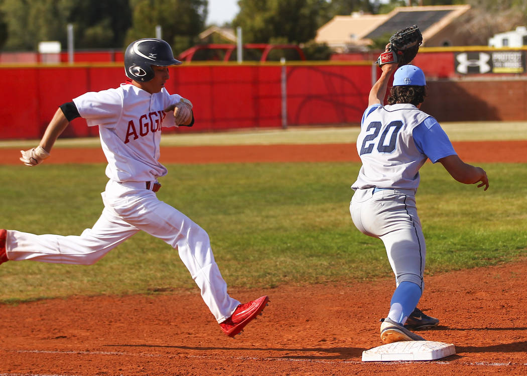 Arbor View's Nick Cornman (4) is tagged out by Centennial's Brett Berger (20) at ...