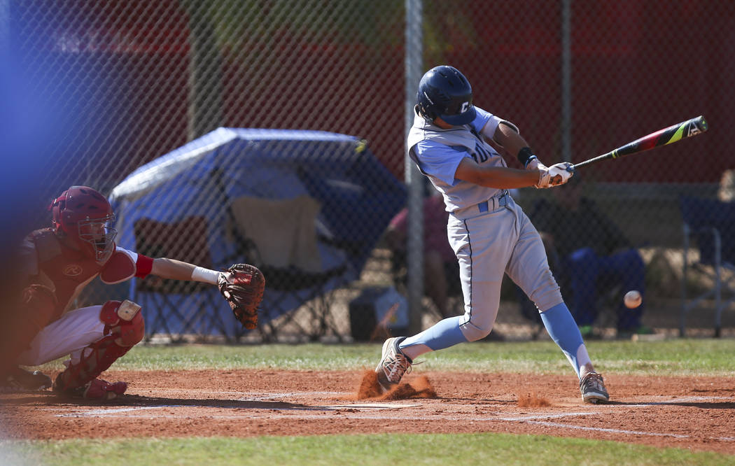 Centennial's Zachary Hare (5) hits the ball against Arbor View during a baseball game ...