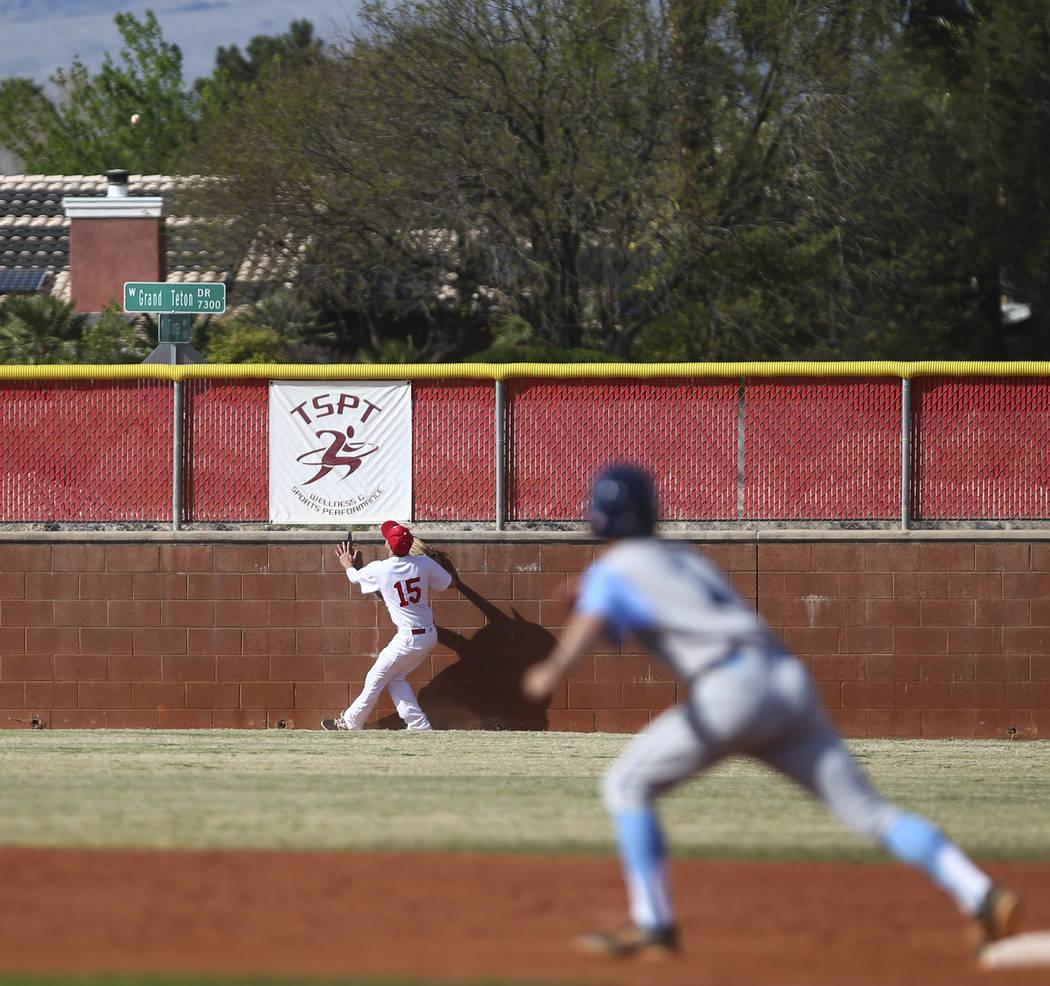Arbor View's Jacob Hamilton (15) watches a home run ball from Centennial's Austi ...