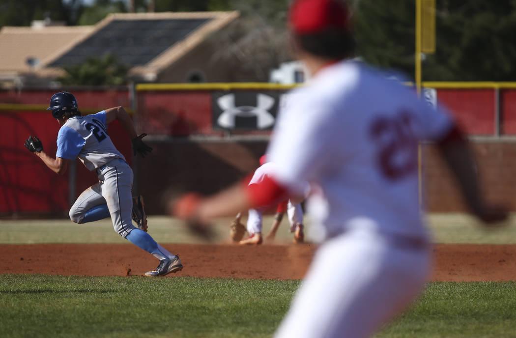 Centennial's Brett Berger (20) runs for third base during a baseball game against Arbo ...