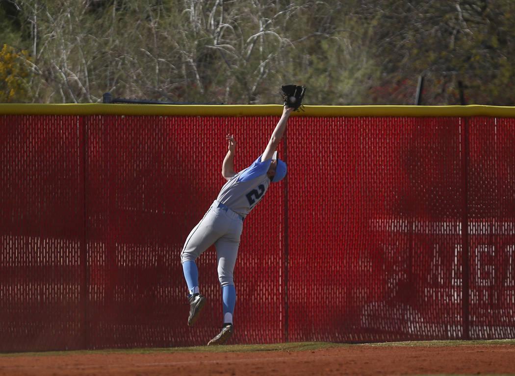 Centennial's Garrett Holden (21) catches a fly ball from Arbor View's Nick Cornm ...