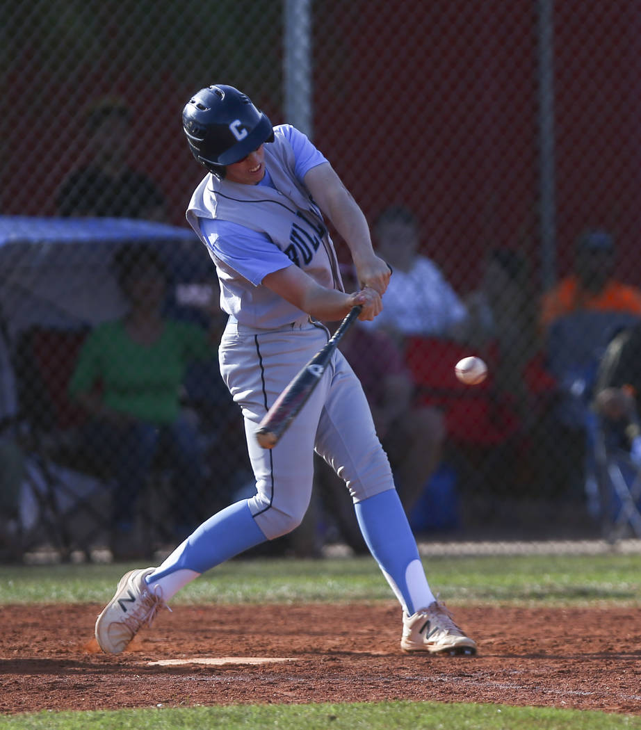 Centennial's Jake Rogers (42) hits the ball allowing two runs during a baseball game a ...
