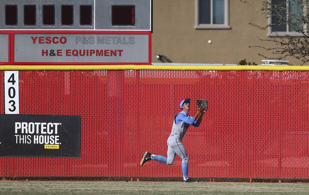 Centennial's Gino Sabey (12) catches a fly ball from Arbor View's Joe Fitzhugh ( ...