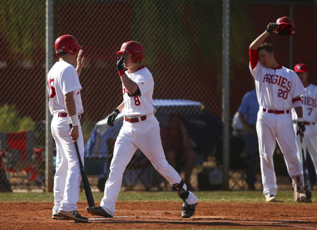 Arbor View's Logan Santos (8) celebrates his home run with Arbor View's Jacob Ha ...