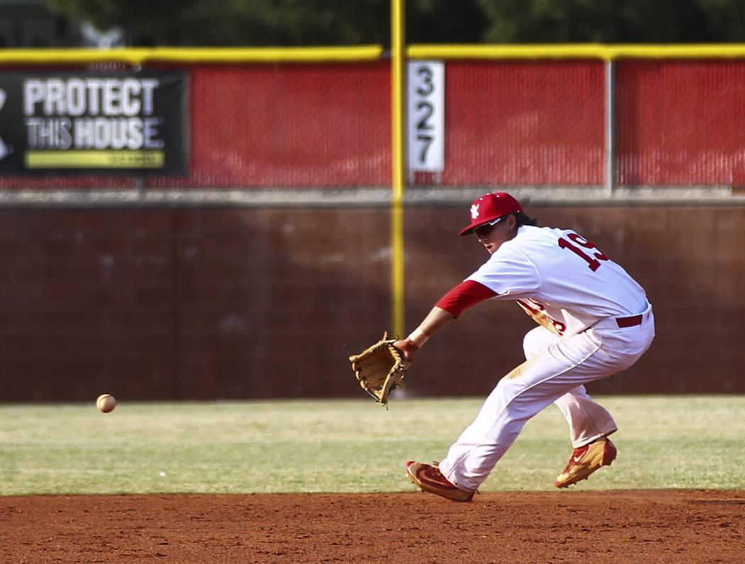 Arbor View's Talon LeBaron (19) misses a grounder from Centennial during a baseball ga ...