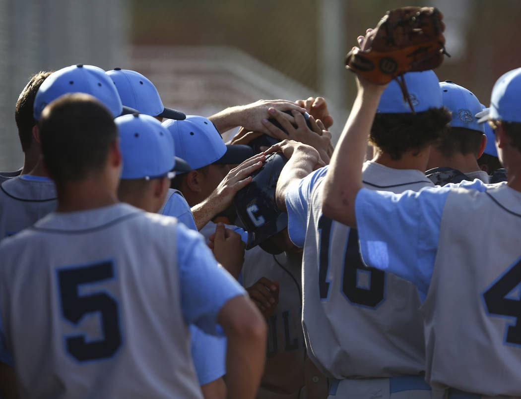 Centennial players celebrate two runs scored against Arbor View during a baseball game at Ar ...