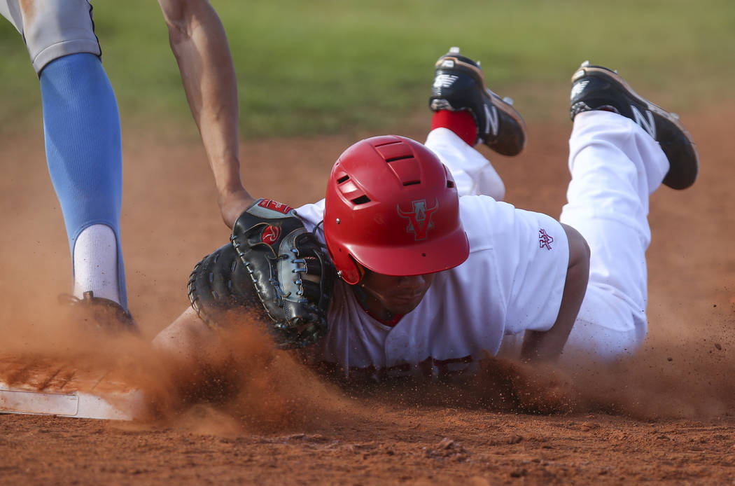 Arbor View's Nick Roeper (11) safely gets to back to first base against Centennial&#82 ...
