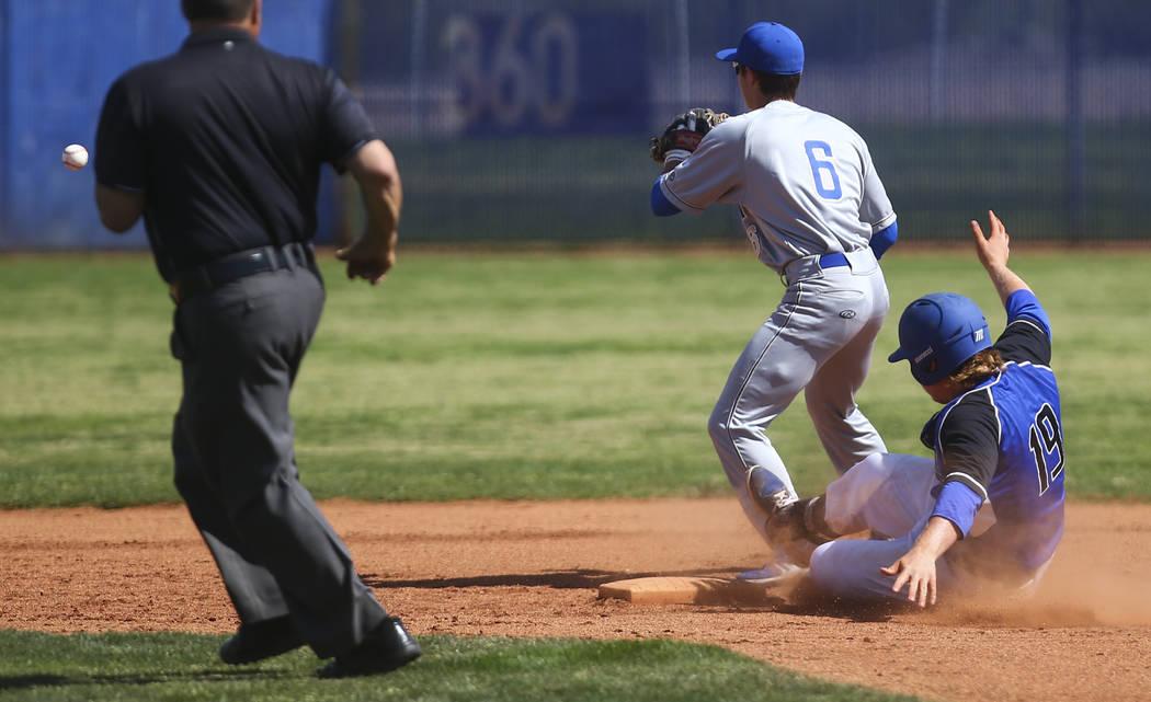 Basic's Jack Wold (19) slides safely into second base against Santa Margarita's ...