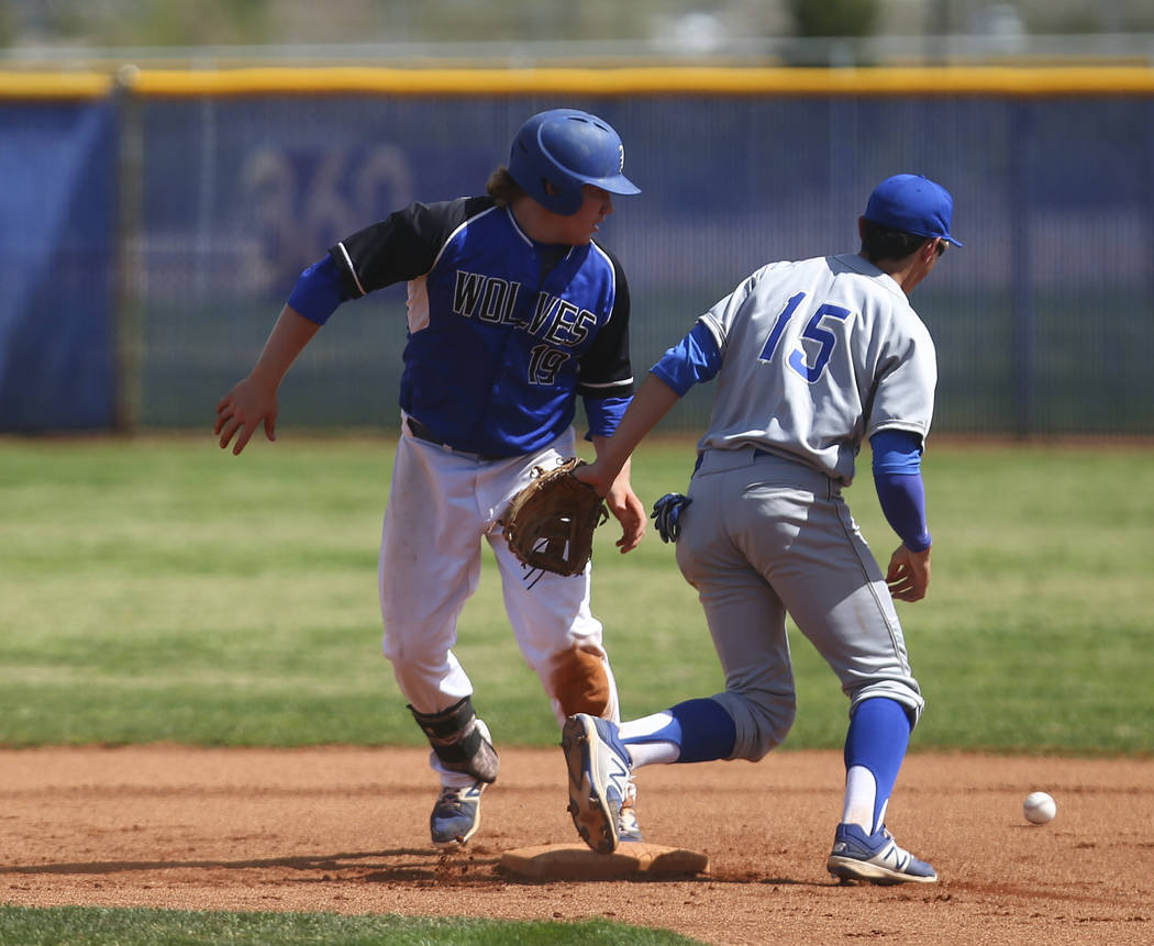 Basic's Jack Wold (19) makes it safely to second base against Santa Margarita's ...