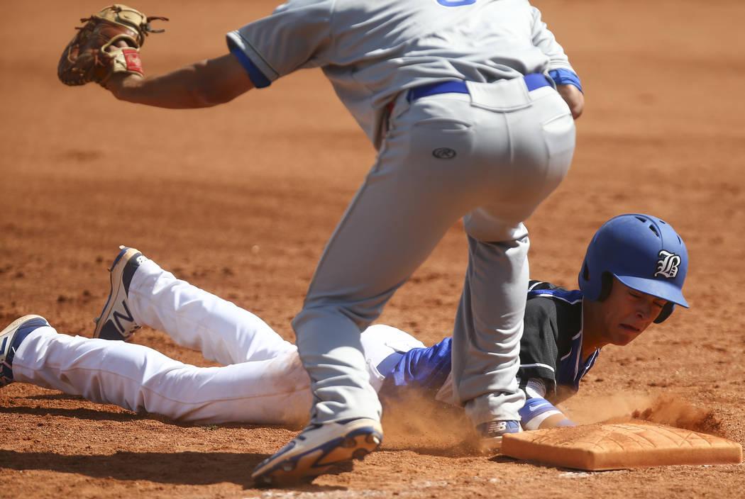 Basic's John Howard Bobo (6) slides back into first base to stay safe against Santa M ...