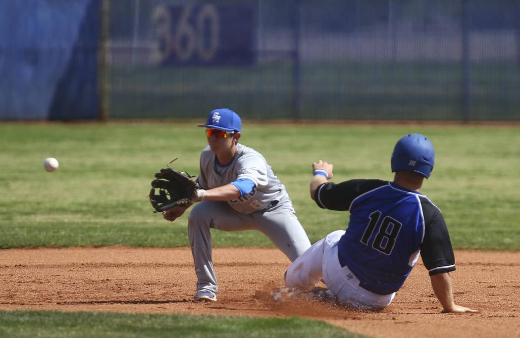 Basic's Trace Evans (18) steals second base against Santa Margarita's Austin Vil ...