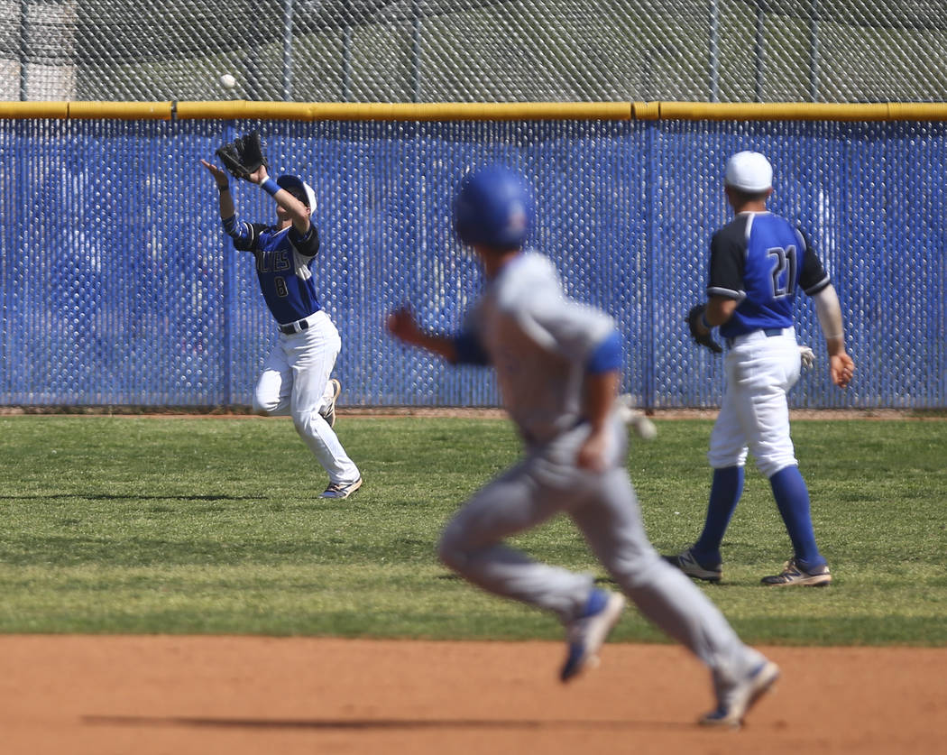 Basic's Kyle Turner (8) catches a fly ball from Santa Margarita during a baseball game ...