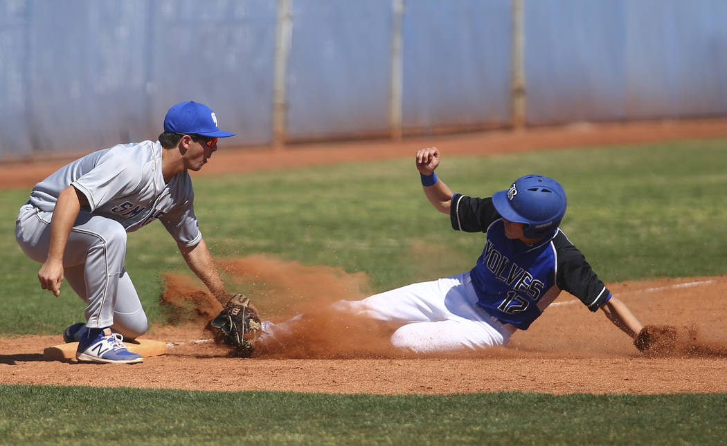 Santa Margarita's Joey Myers (2) tags out Basic's Brady Clark (12) during a base ...
