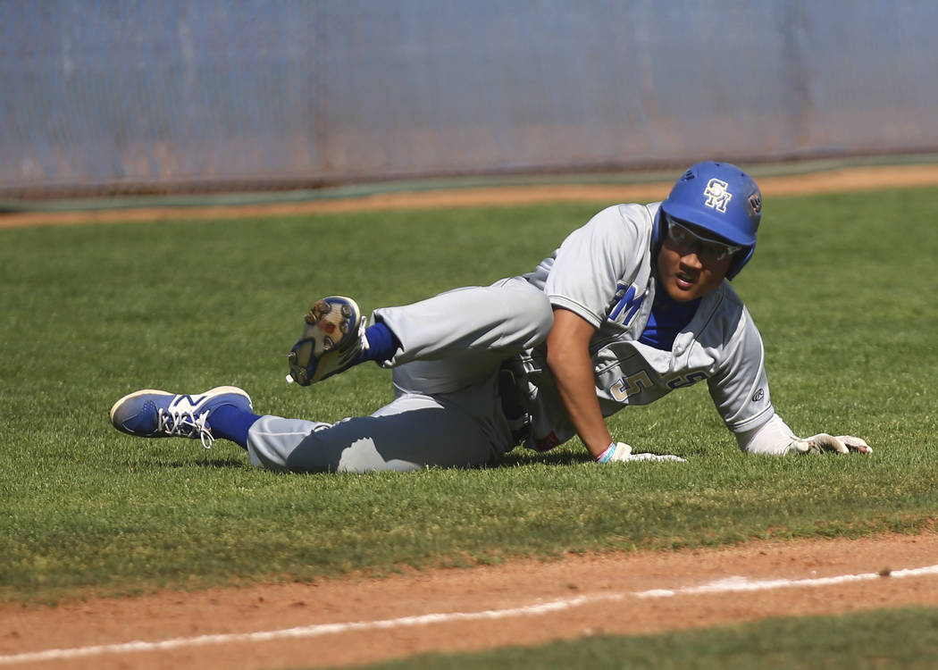 Santa Margarita's Derek Park (5) trips up before getting tagged out by Basic during a ...